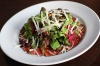 Beef Carpaccio - Thinly Sliced Marinated Beef, Served With A Mixed Green, Pine Nuts And Shaved Parmesan Salad